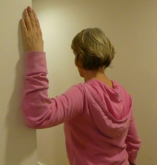 Stretching against a wall