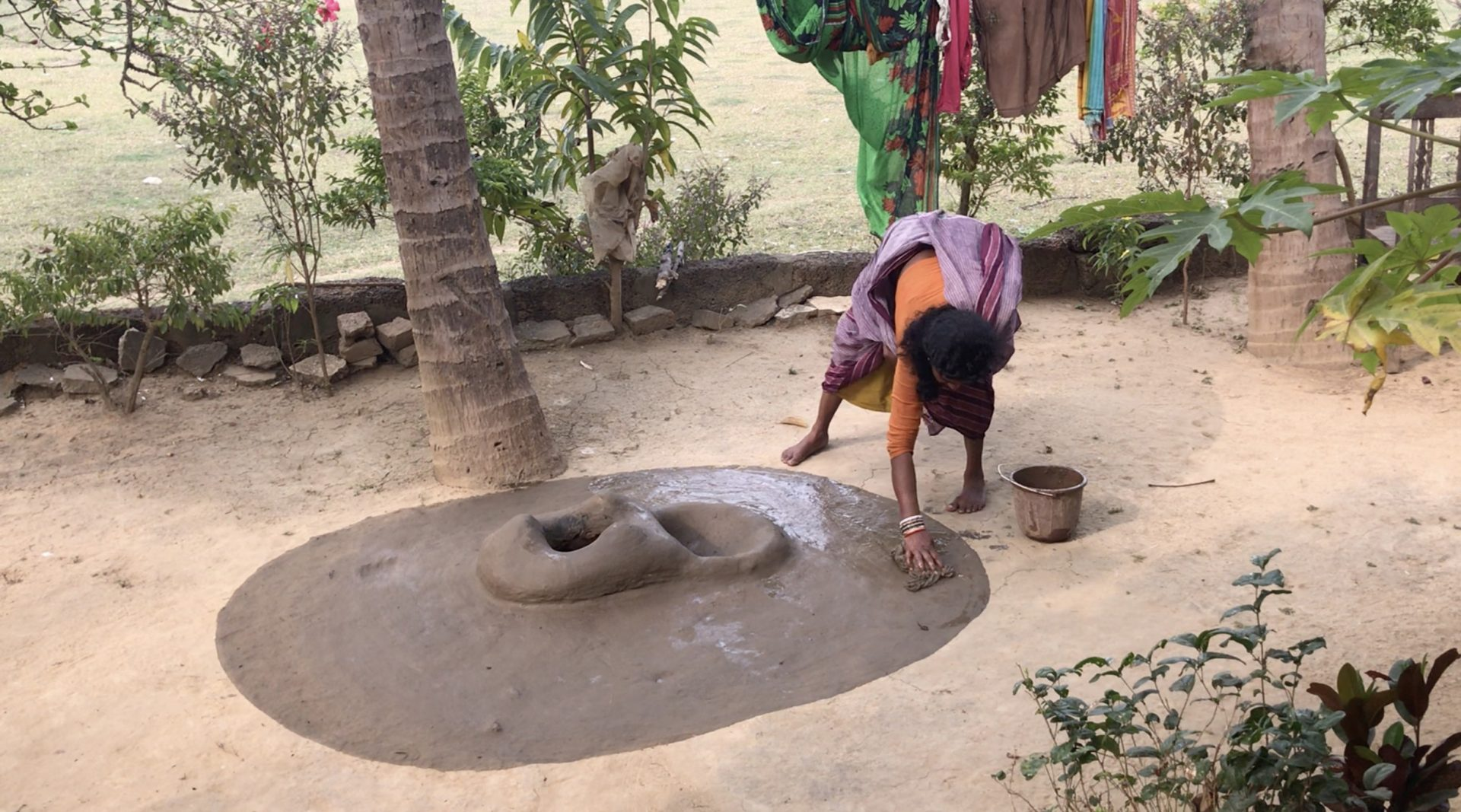 Indian woman washing the stove